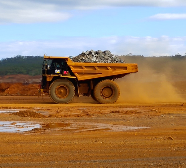 CAT 777 Dump Trucks Equipped with 27.00R49 Off the Road Tires Running on Nickel Mine